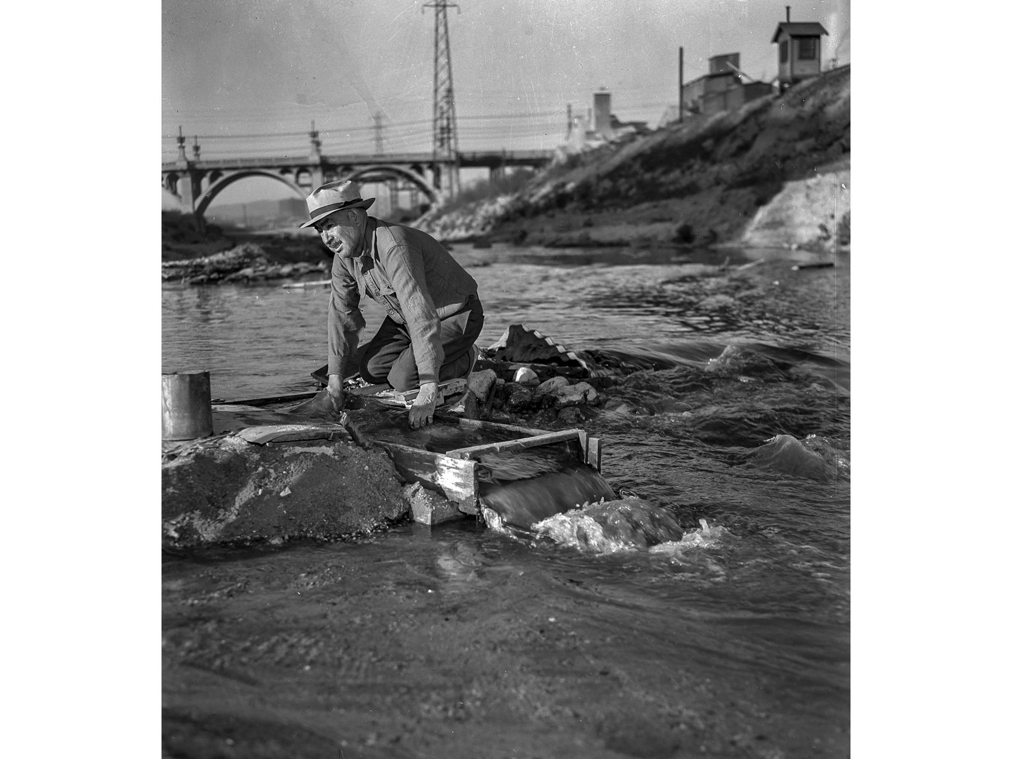 Dec. 11, 1938: Antonio Chacon uses a sluice box to look for gold in the Los Angeles River. This pho