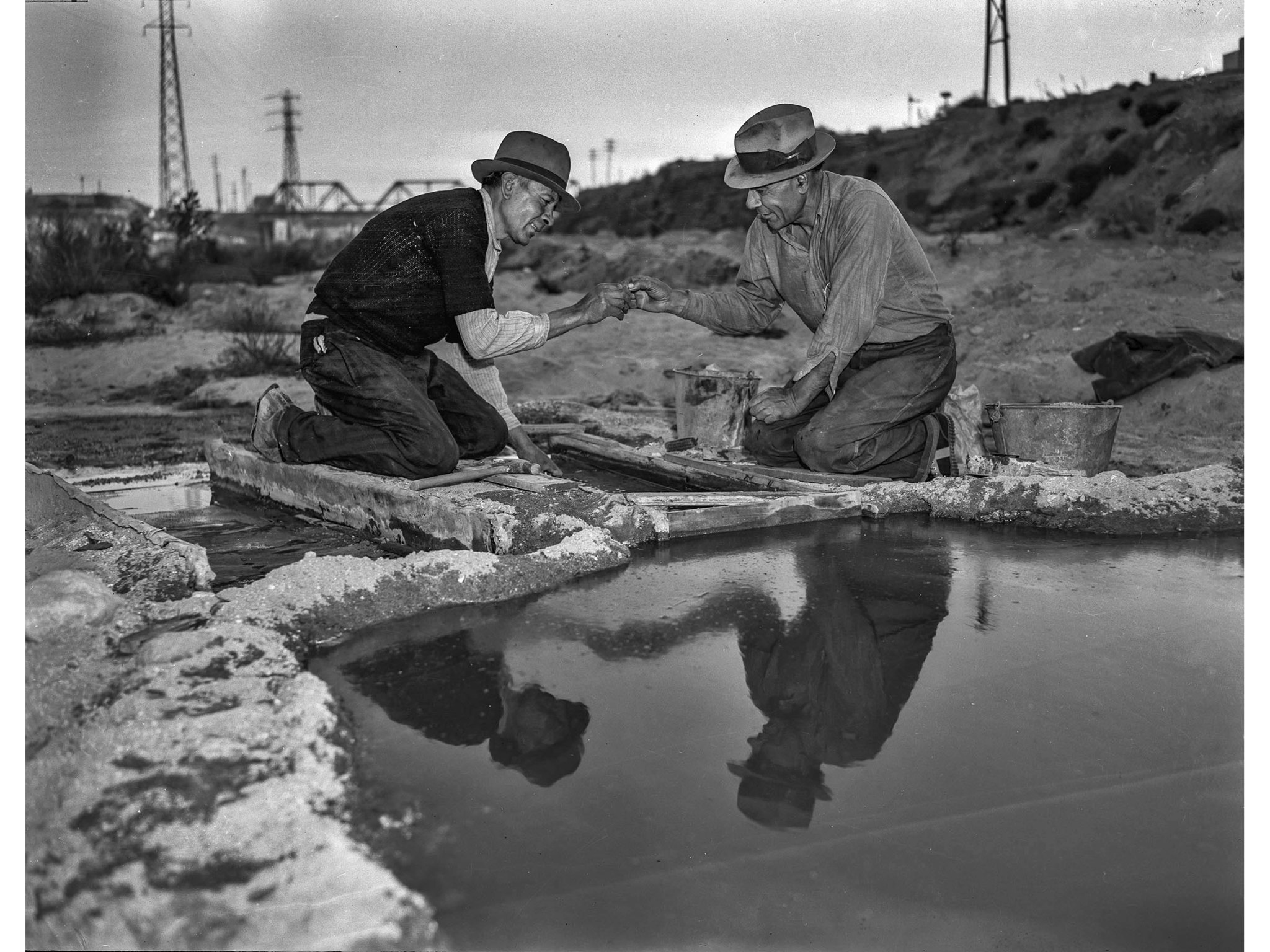 Dec. 11, 1938: Joe Parra, left, and E. Rea examine a gold nugget found in sand in Los Angeles River.