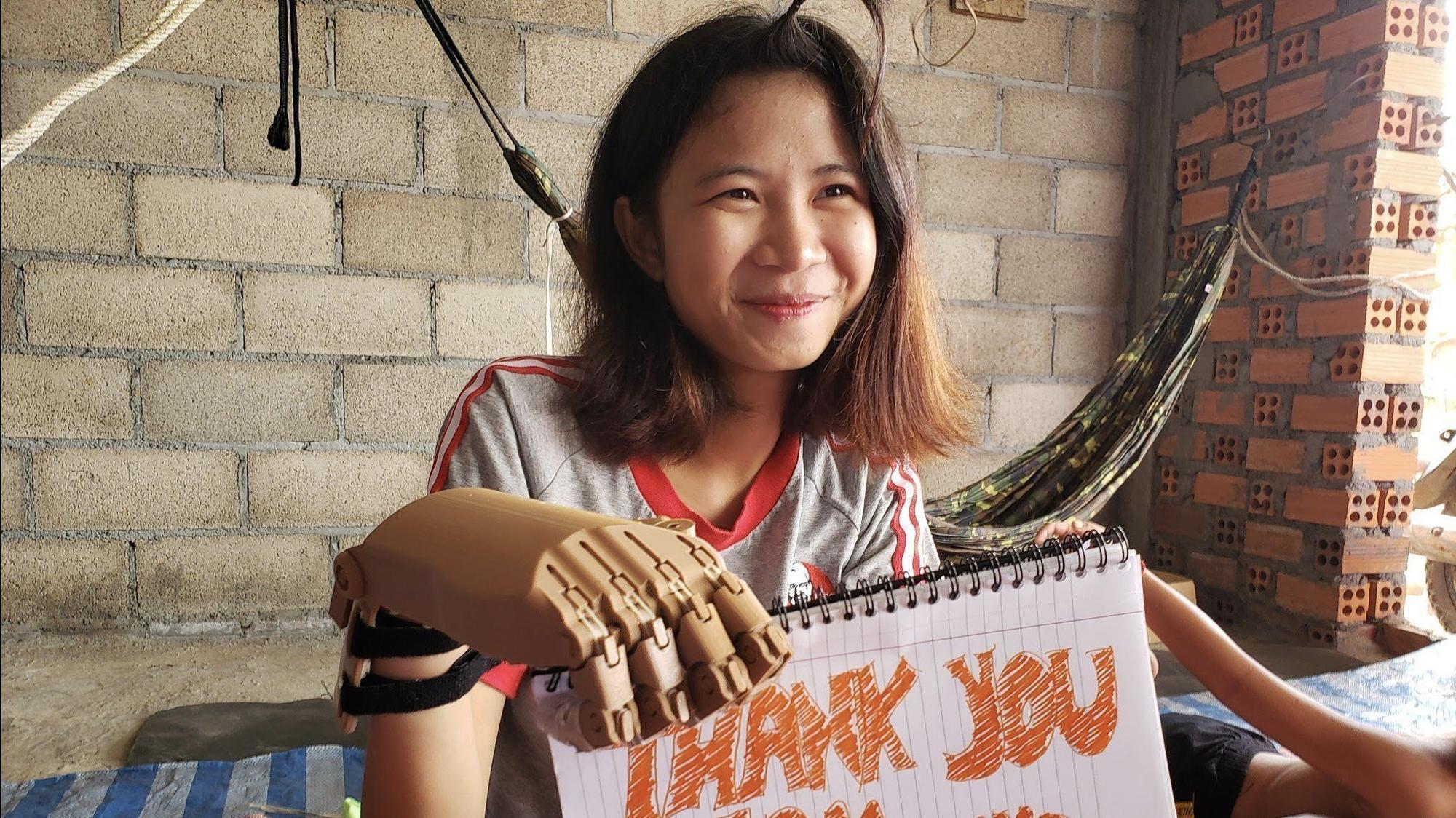 Brother Rice robotics students design and build functioning prosthetic hands for Cambodian teen