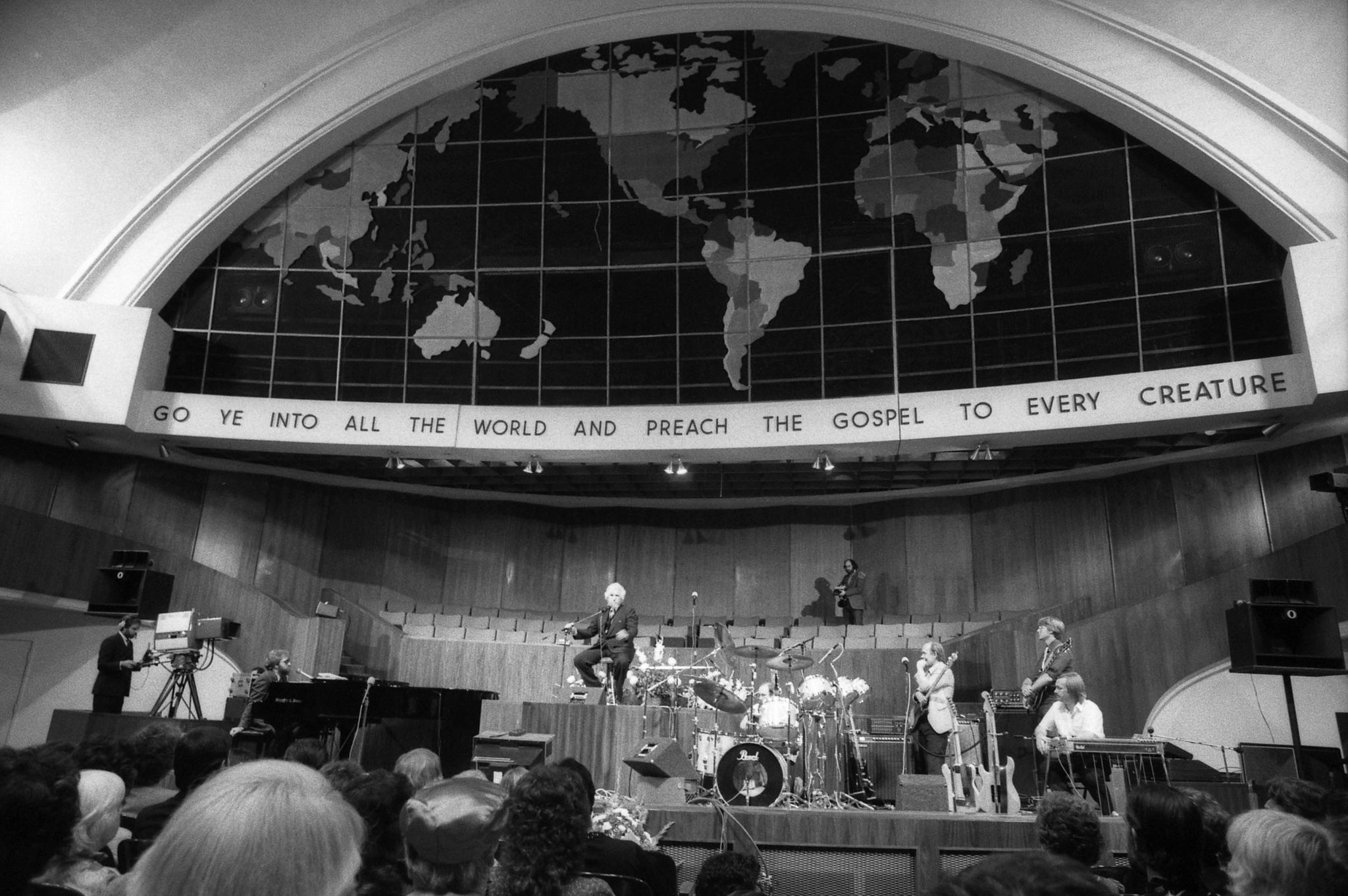July 6, 1986: Dr. Gene Scott on stage of Church of the Open Door in Los Angeles. This image is from