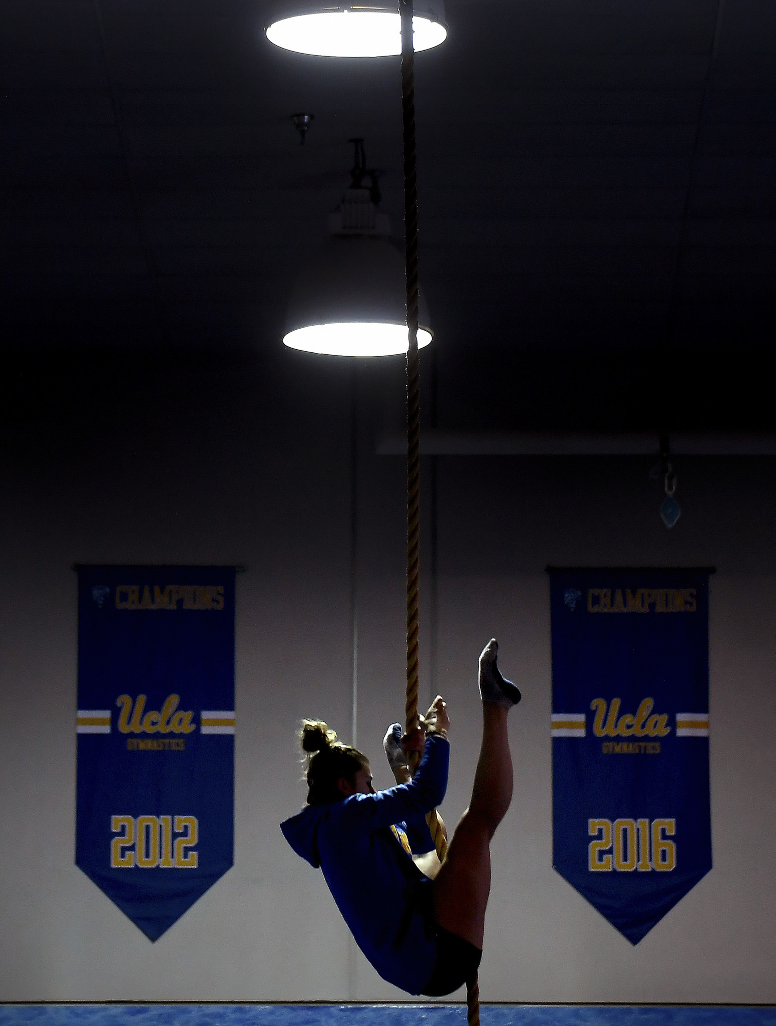 UCLA gymnast Pauline Tratz climbs a rope during a workout on the UCLA campus.