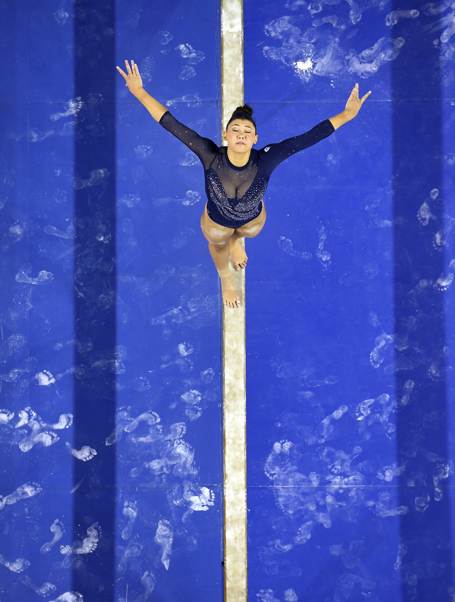 UCLA gymnast Kyla Ross competes on the beam at Pauley Pavilion.