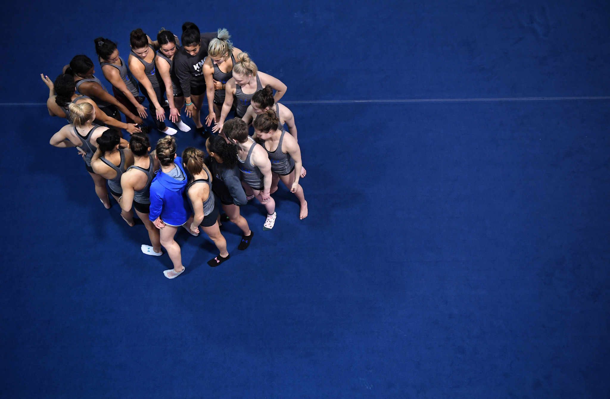 Gymnasts gather before practice at UCLA.