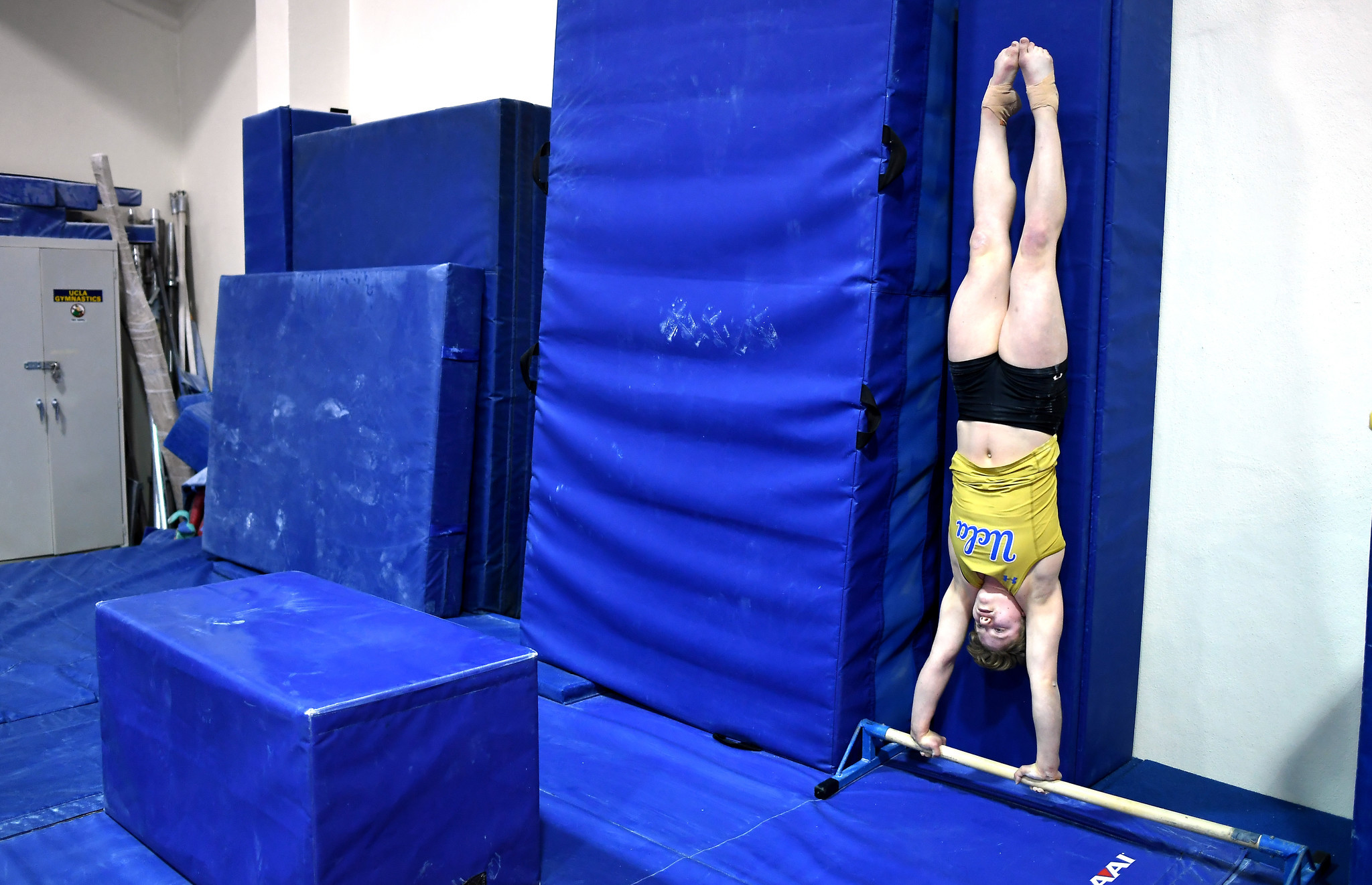 A UCLA gymnast works out on the UCLA campus.