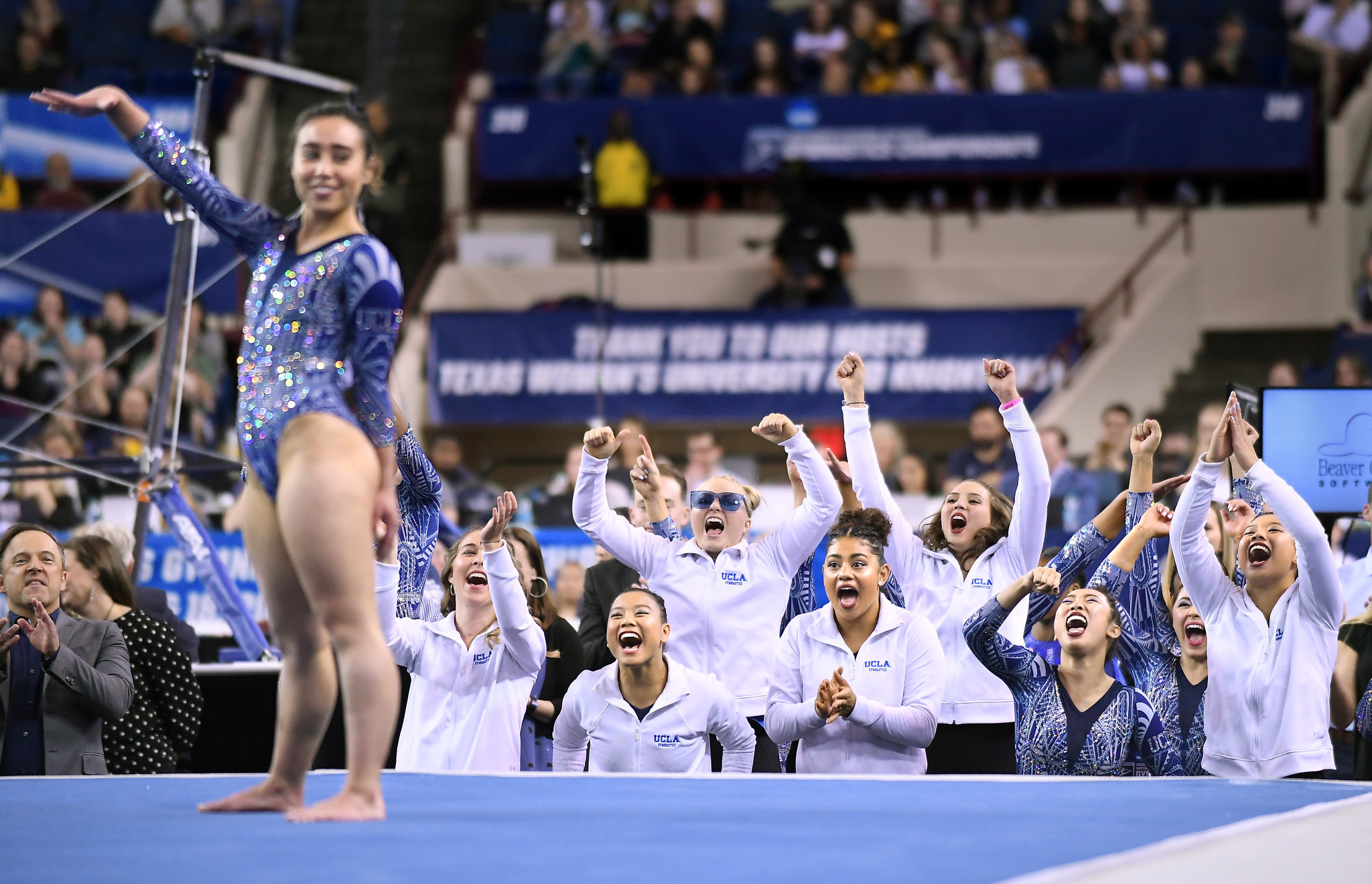 UCLA's Katelyn Ohashi completes her floor routine as teammates cheer her on during NCAA semifinals in Fort Worth.