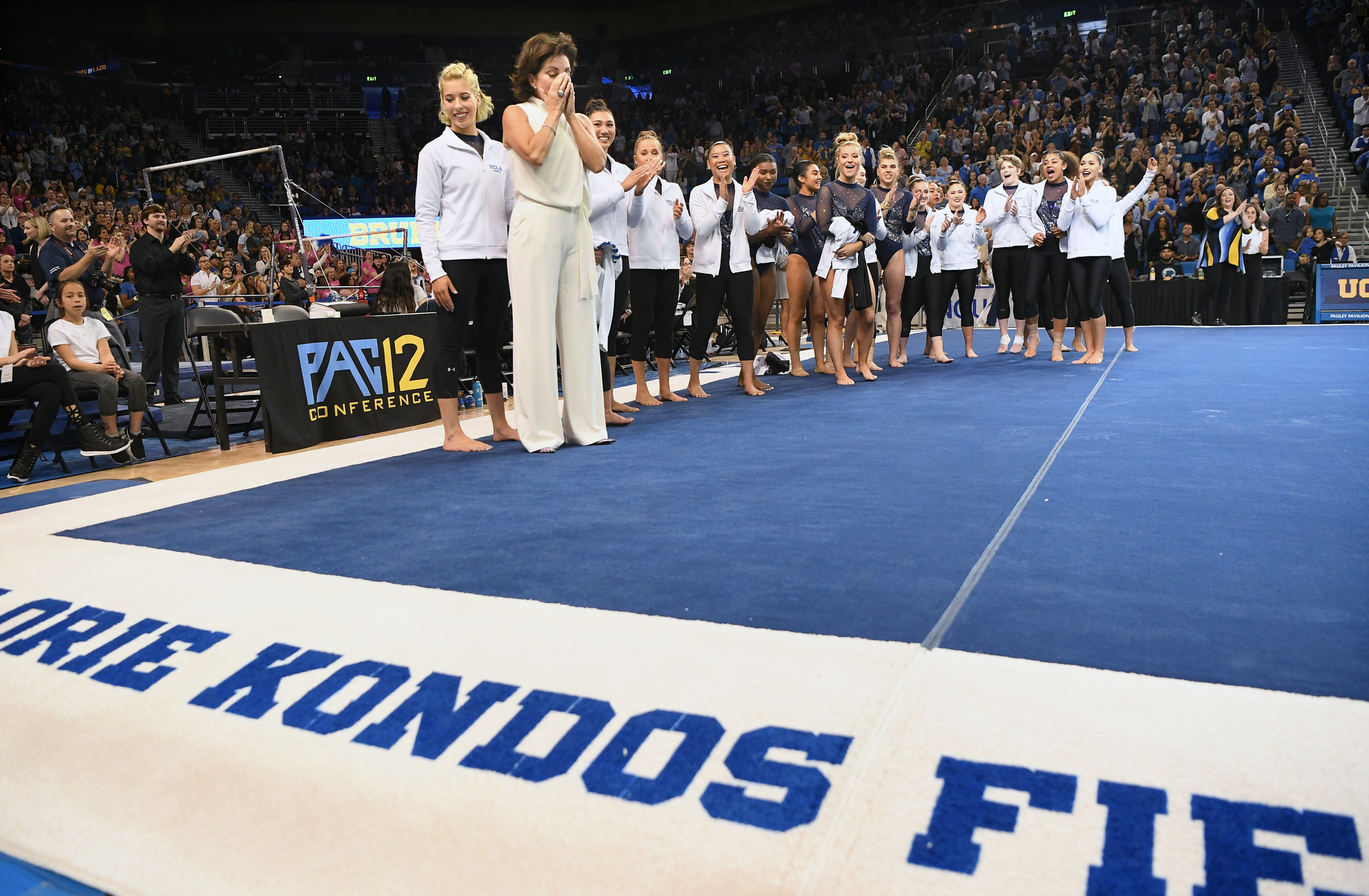 UCLA coach Valorie Kondos Field seems surprised at her named is unveiled on the floor during a dedication ceremony at Pauley Pavilion.
