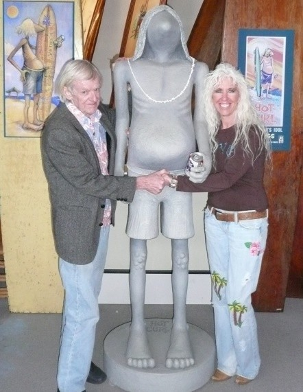 Mike Dormer and his friend, Terry Kraszewski, donate a replica Hot Curl statue to the California Surf Musem in Oceanside in the late '90s. (It's still there today.)