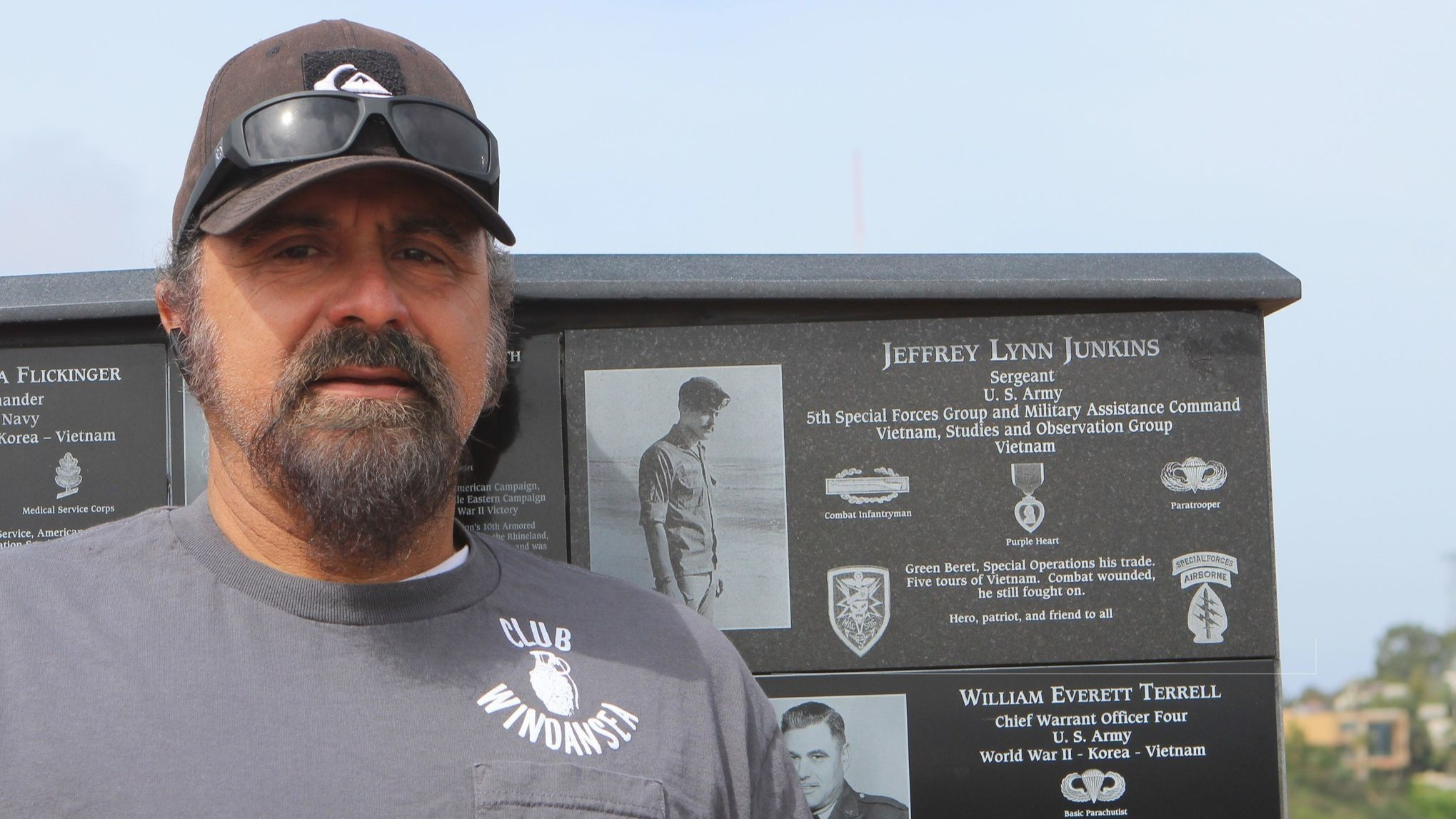Azad Abbasi speaks about Junkins  in front of his late friend's plaque at the Mt. Soledad National Veteran's Memori