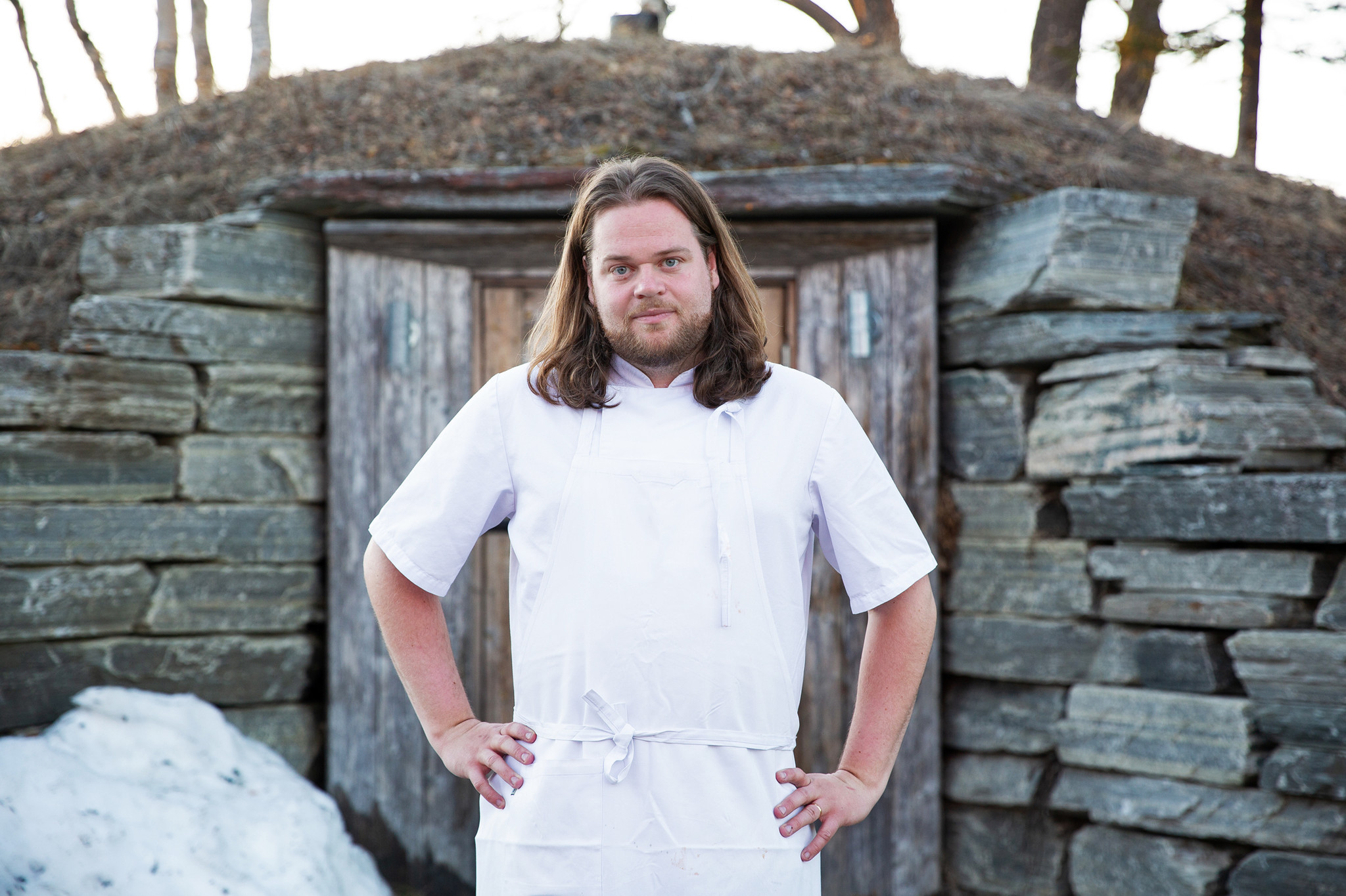 Chef Magnus Nilsson in front of his famous root cellar at Fäviken.