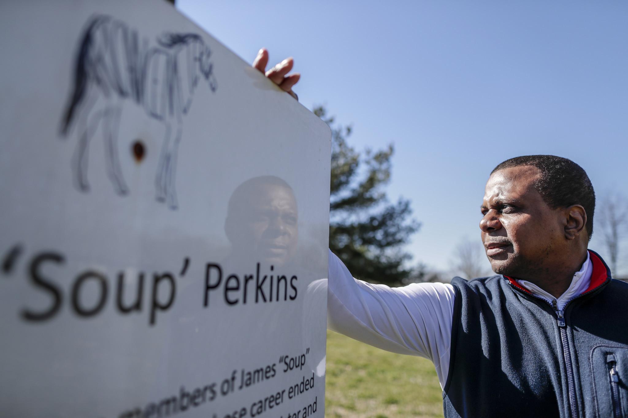 Leon Nichols at a sign honoring James Perkins