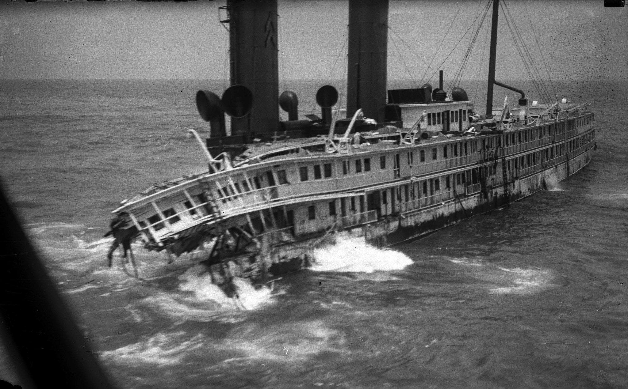 June 12, 1931: Wreck of S.S. Harvard is taken in aerial photo two weeks after the passenger ship ran