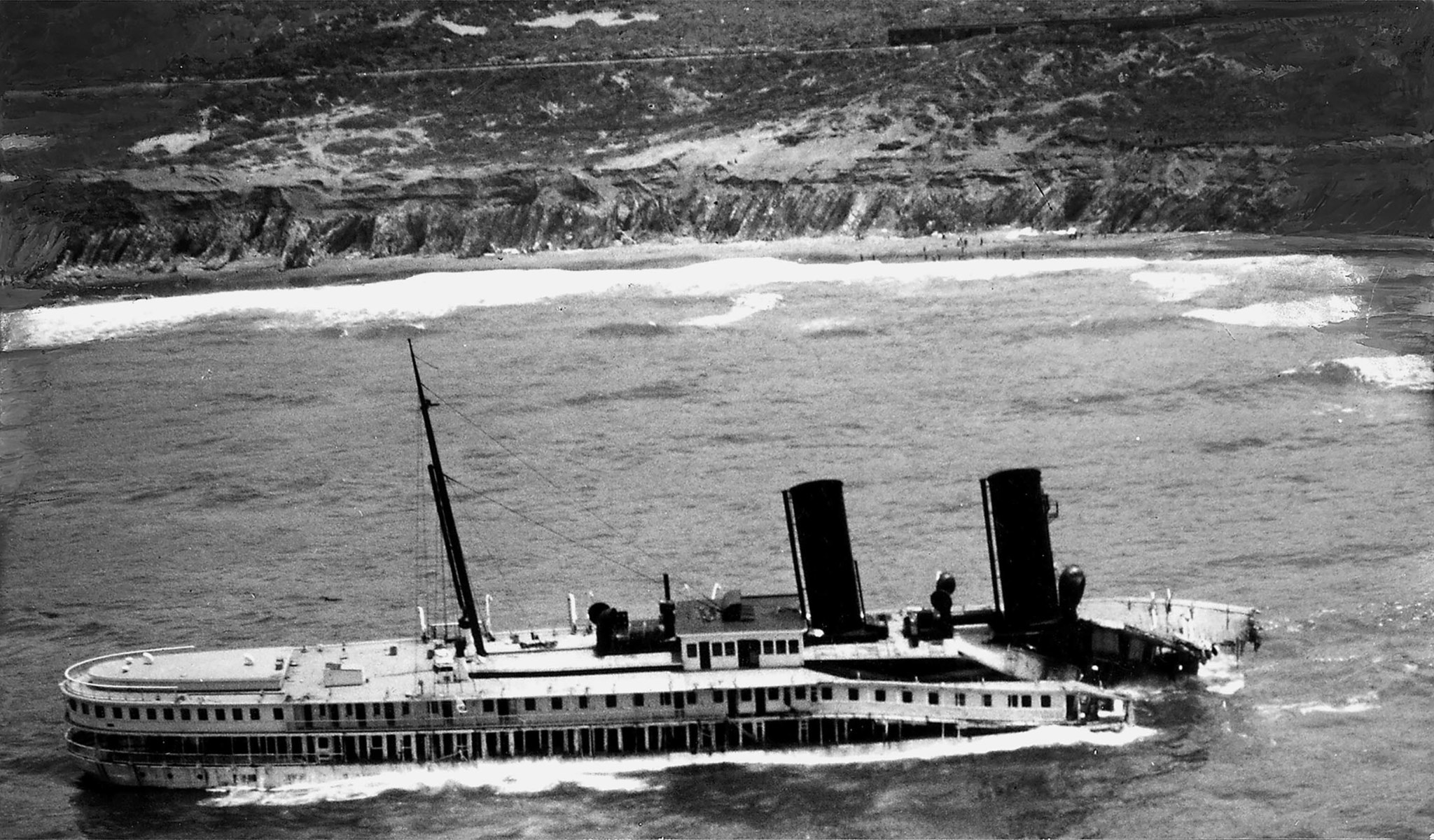 June 1931: Aerial photo of wreckage of S.S. Harvard after May 30, 1931 grounding in fog at Point Arg