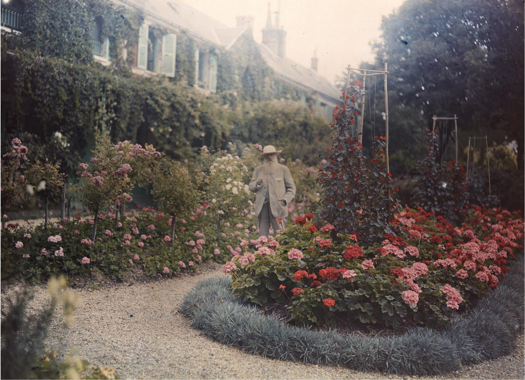 Claude Monet in his Giverny, France, garden in 1921.