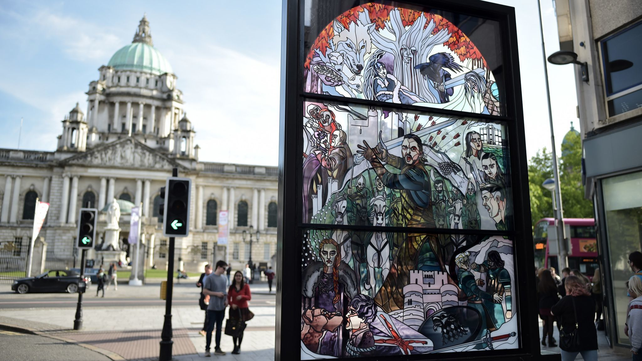 A stained glass art installation depicting scenes from