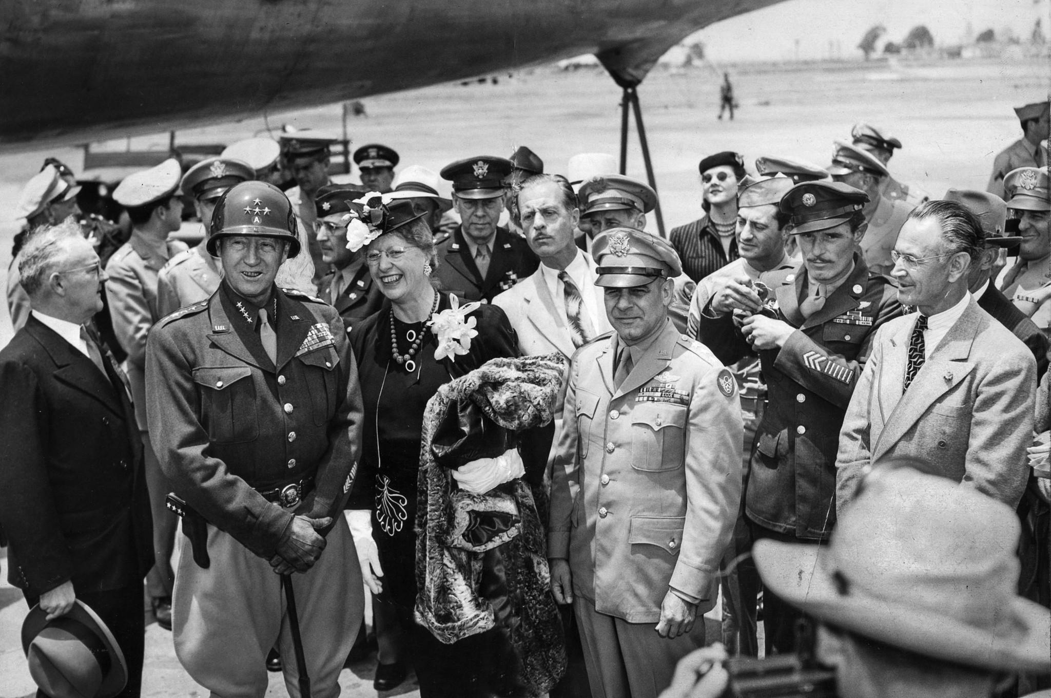 June 9, 1945: After arrival in Los Angeles from Denver, mayor Fletcher Bowron, left, welcomes Gen. G