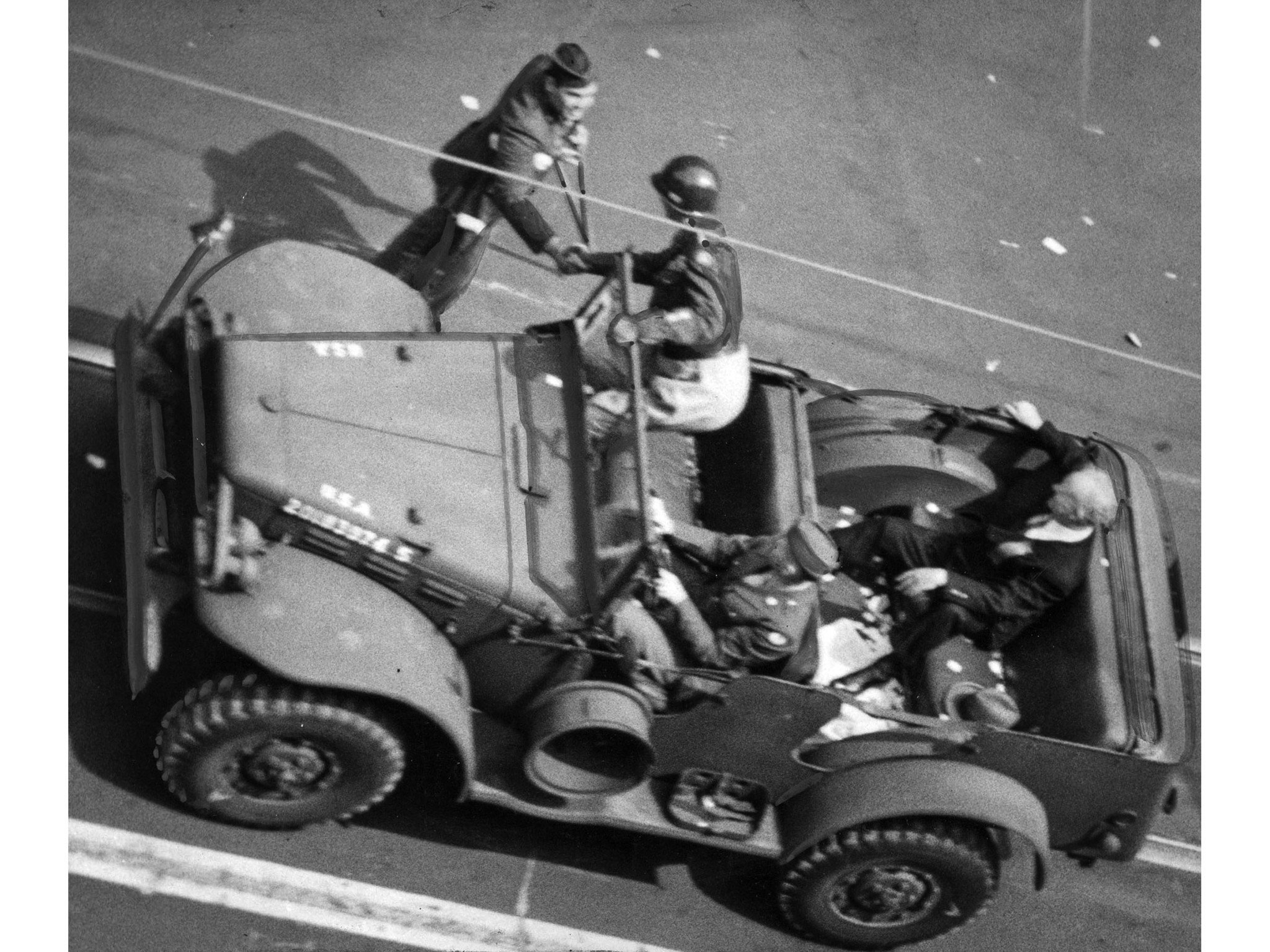 June 9, 1945: Gen. George S. Patton Jr., stops jeep during parade to shake hands with soldier who ha