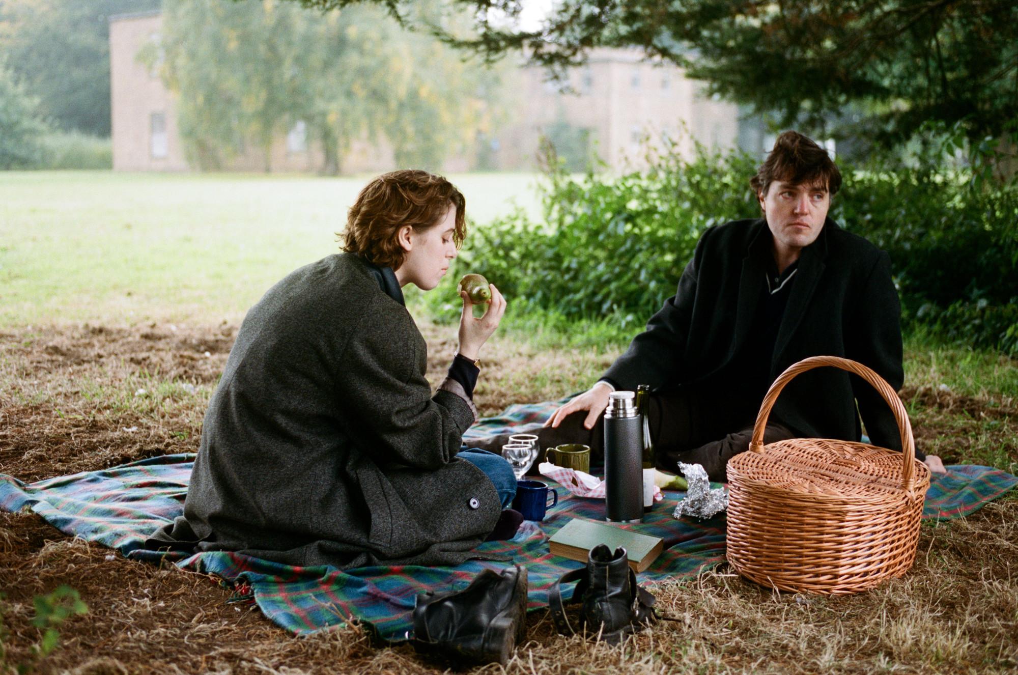 Honor Swinton Byrne, left, and Tom Burke in a scene from