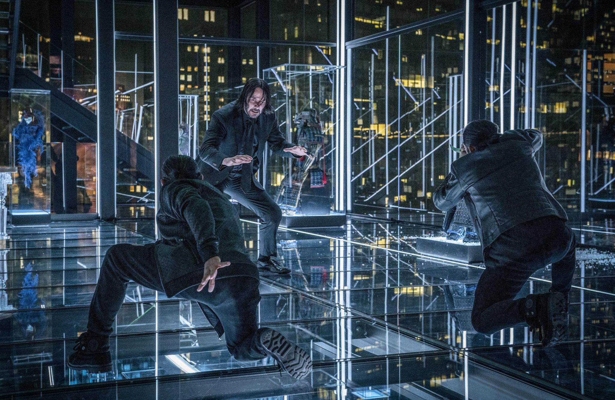 Keanu Reeves, center, stars as John Wick in