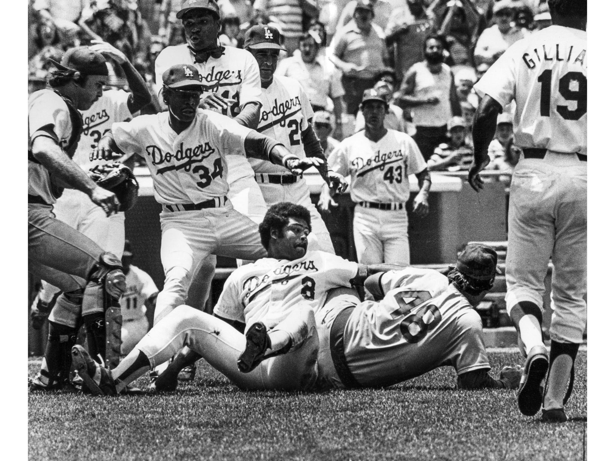 June 19, 1977: Dodgers' Reggie Smith (#8), still trying to get Cubs' pitcher Rick Reuschel after