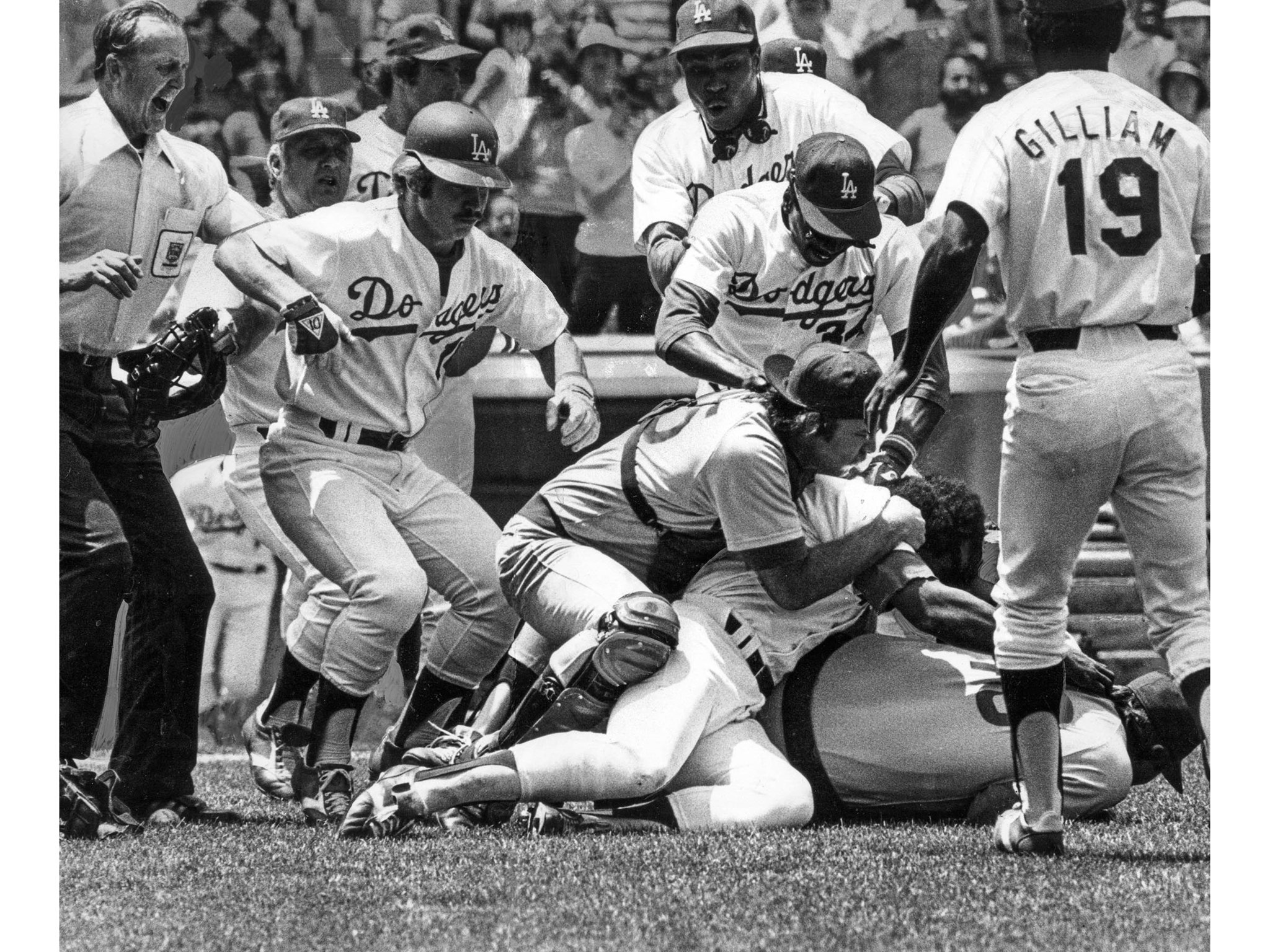 July 19, 1977: Chicago Cubs catcher George Mitterwald is on ground grabbing Dodgers' Reggie Smith