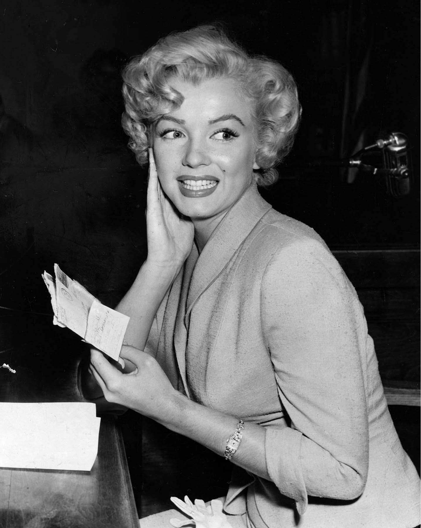 June 26, 1952: Marilyn Monroe in court during trial of two men accused of trying to sell