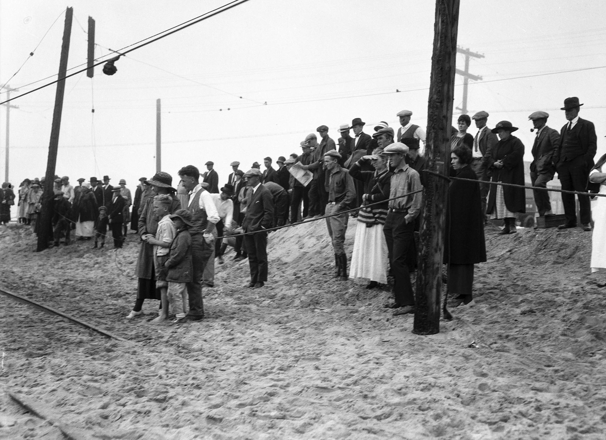June 1, 1924: Spectators looking towards the charred remains of the Hope Development School for men