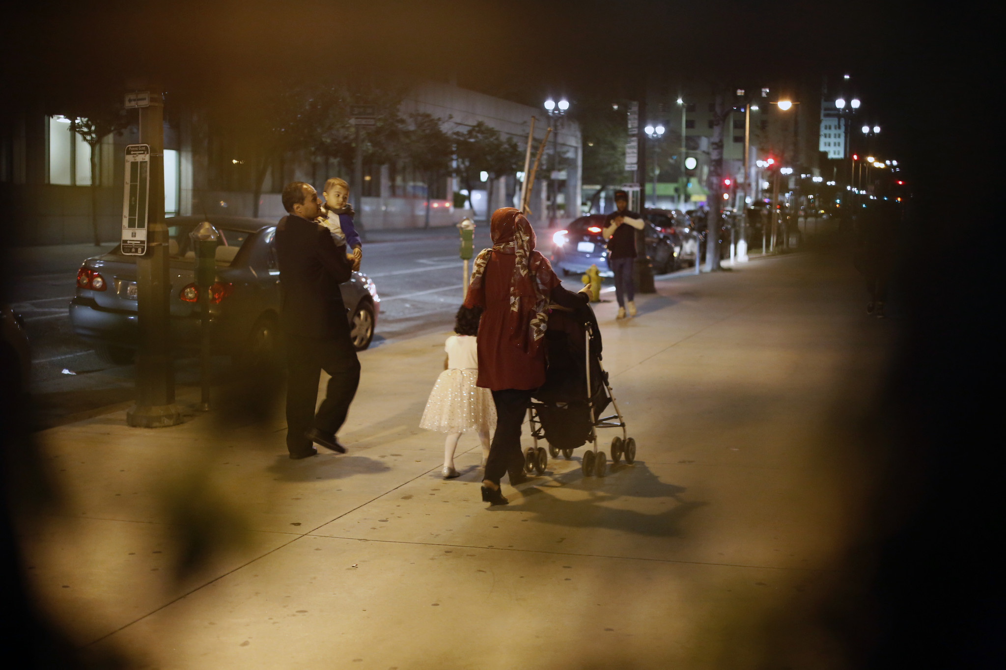LOS ANGELES, CA-MARCH 31, 2019: Bashir Kashefi, left, Naseema Kashefi walk out with their two kids H