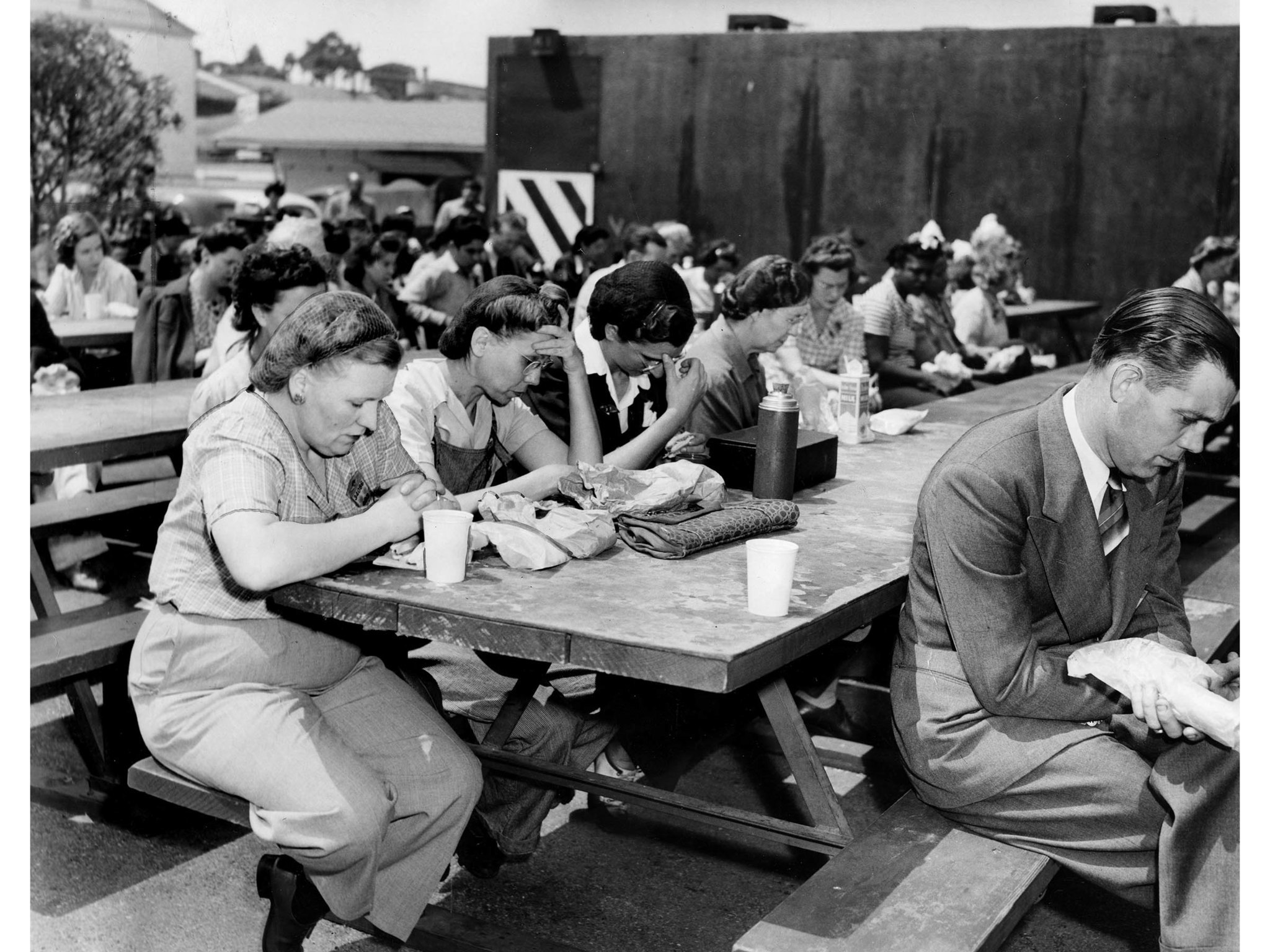June 6, 1944: Douglas Aircraft Co. workers bow in silent prayer during lunch period. This photo was