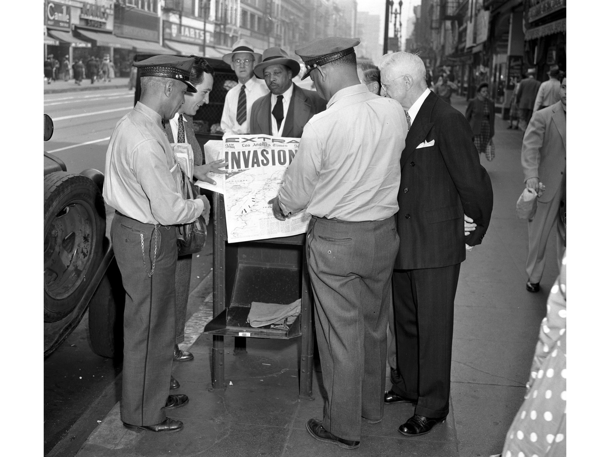 June 6, 1944: Group reads about D-Day Invasion news at 5th and Broadway in downtown Los Angeles. Thi