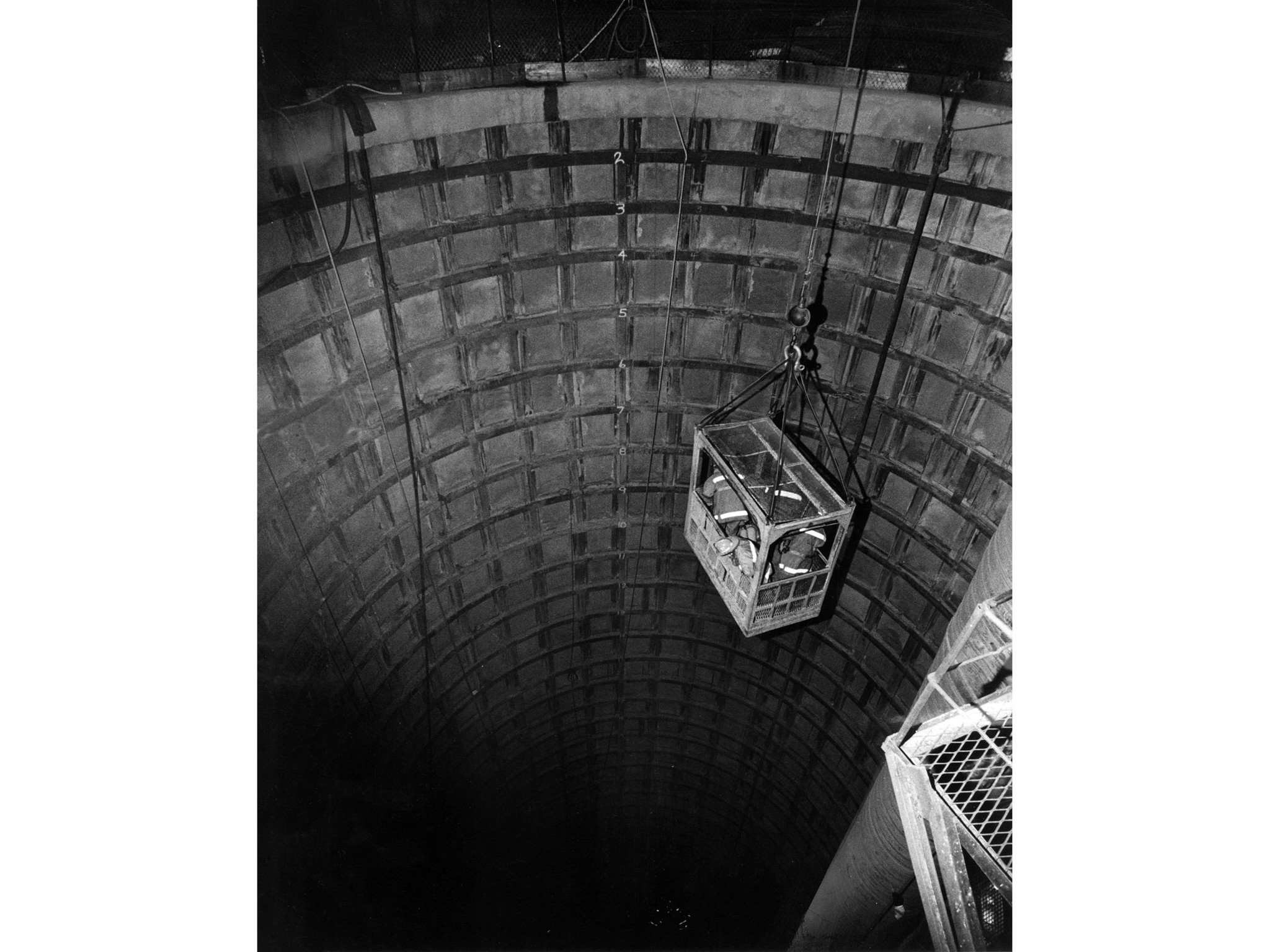June 24, 2971: Firemen are lowered into gate shaft during attemps to rescue miners who were drilling
