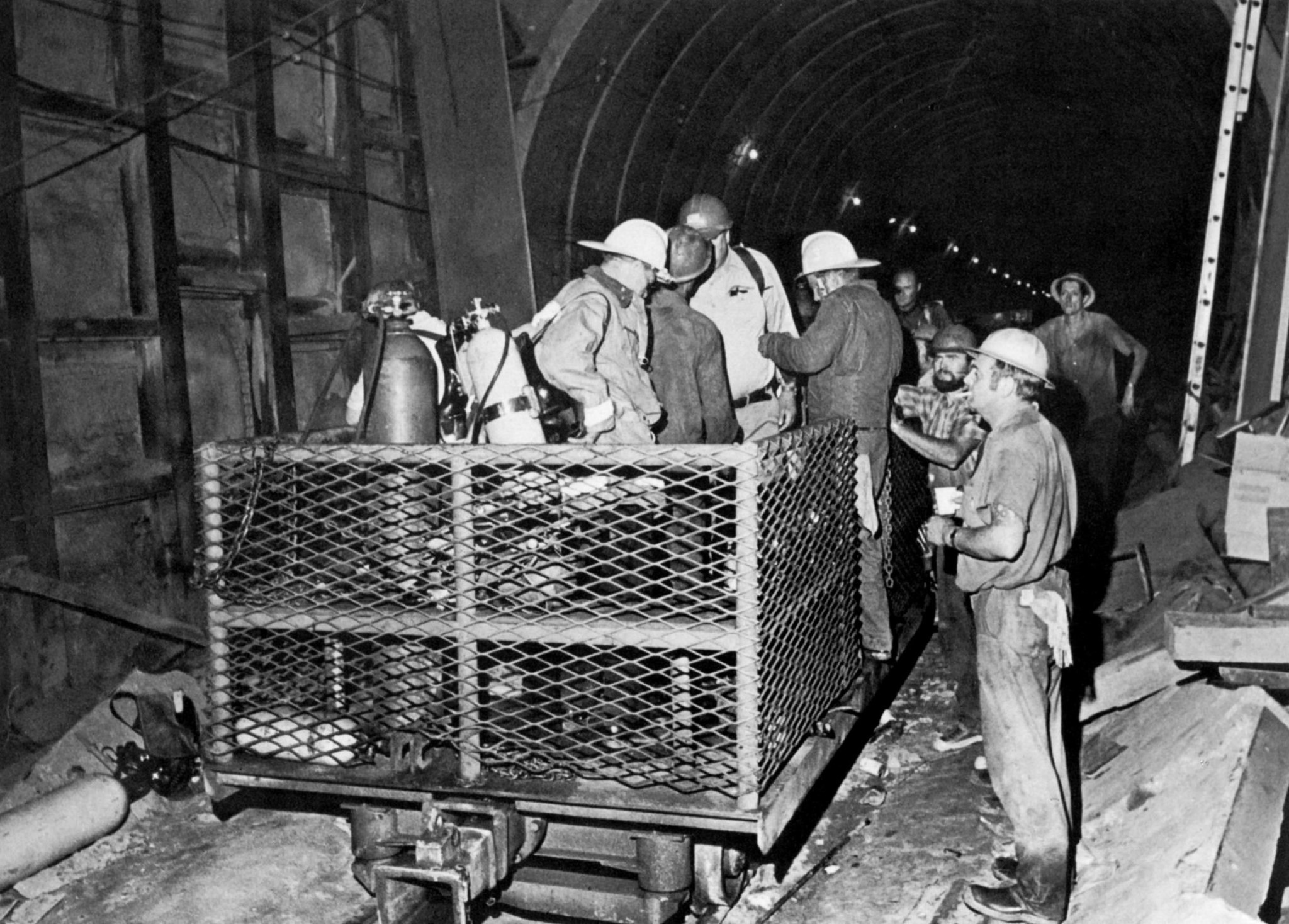 June 24, 1971: Workers and firemen at bottom Gate shaft prepare to search for victims in tunnel. Met