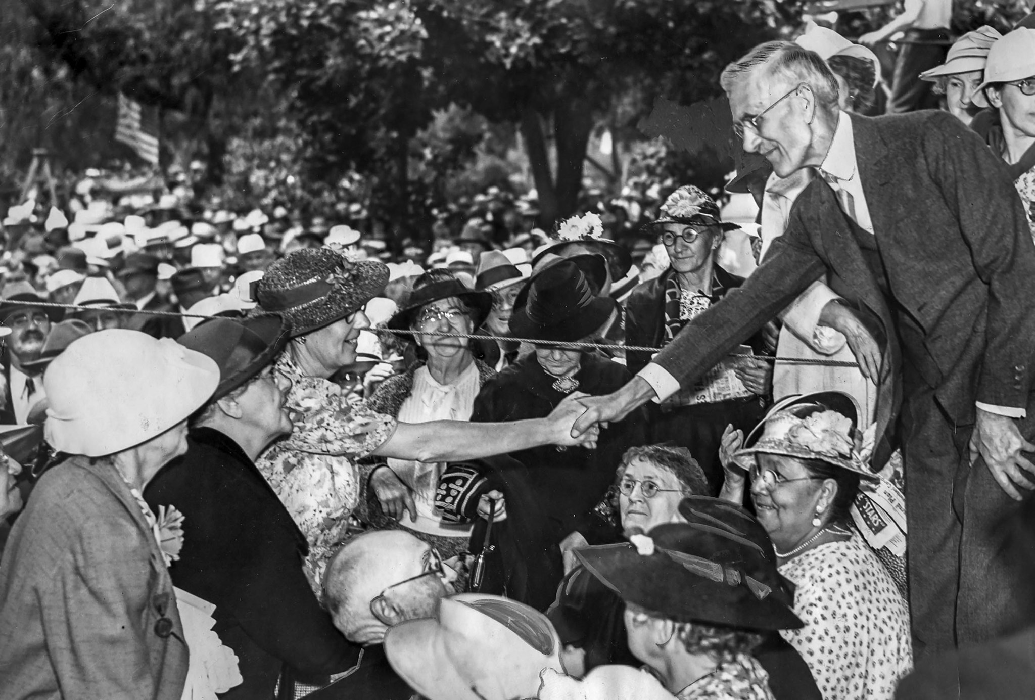 June 23, 1938: Dr. Francis E. Towsend, founder of pension plan, shakes hands with followers at Bixby