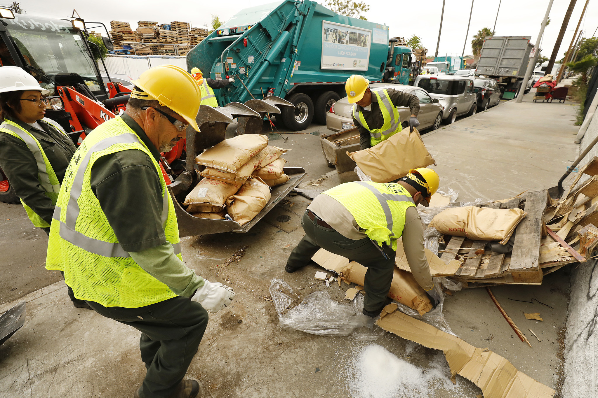 Sanitation crews clean up dumped items