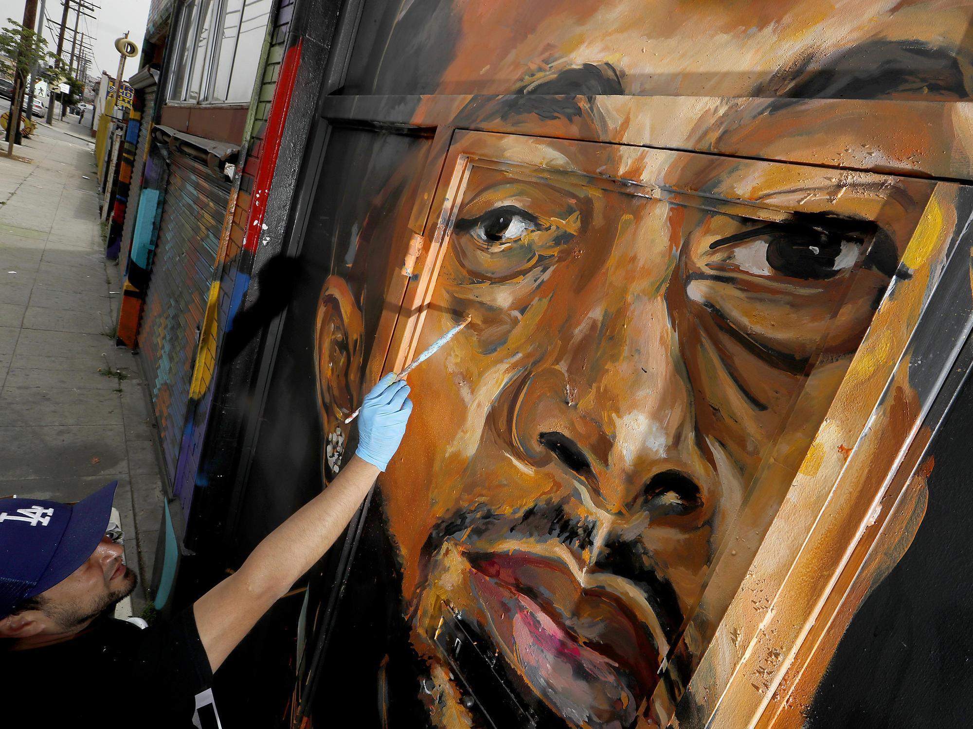 Artist paints Nipsey Hussle mural
