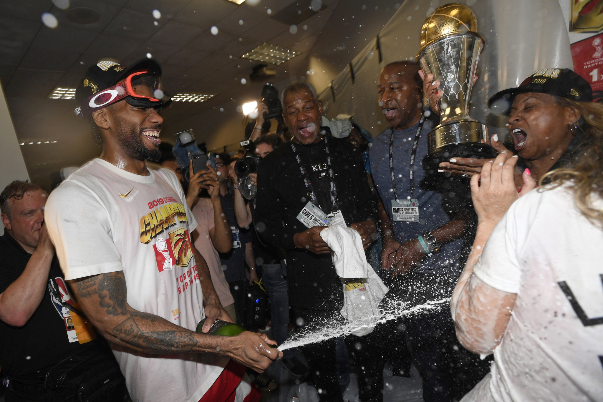 Toronto Raptors forward Kawhi Leonard sprays his mother, Kim Robertson, with sparkling wine after th