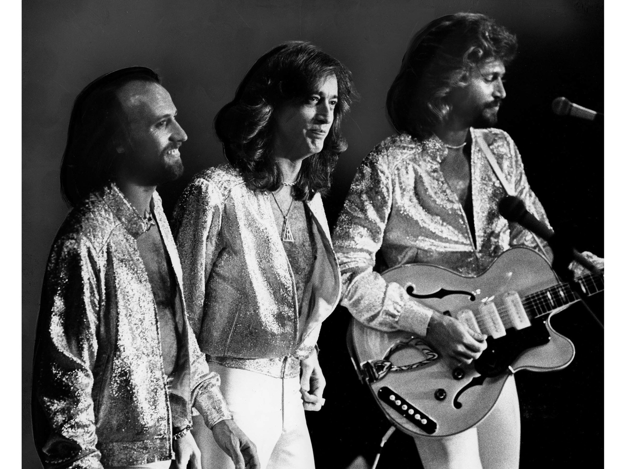 July 7, 1979: The Bee Gees – from left, Maurice, Robin, Barry Gibb – included more than a dozen