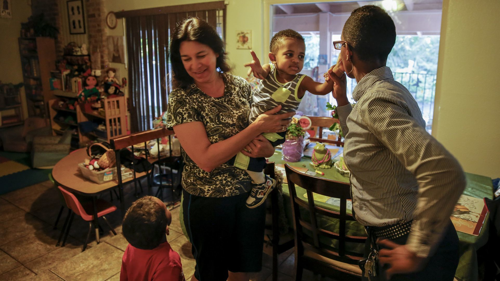 Single mother Francis Brown with her family and child-care provider