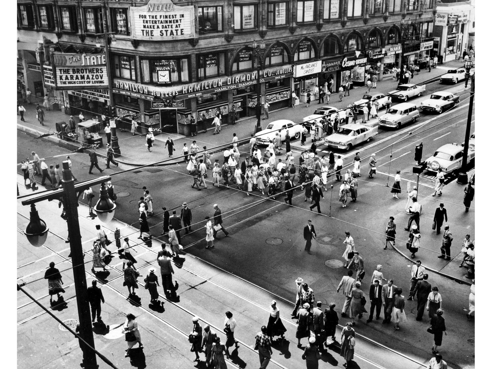 April 1958: Pedestrian traffic at 7th and Broadway about noon. According to a short Los Angeles Time