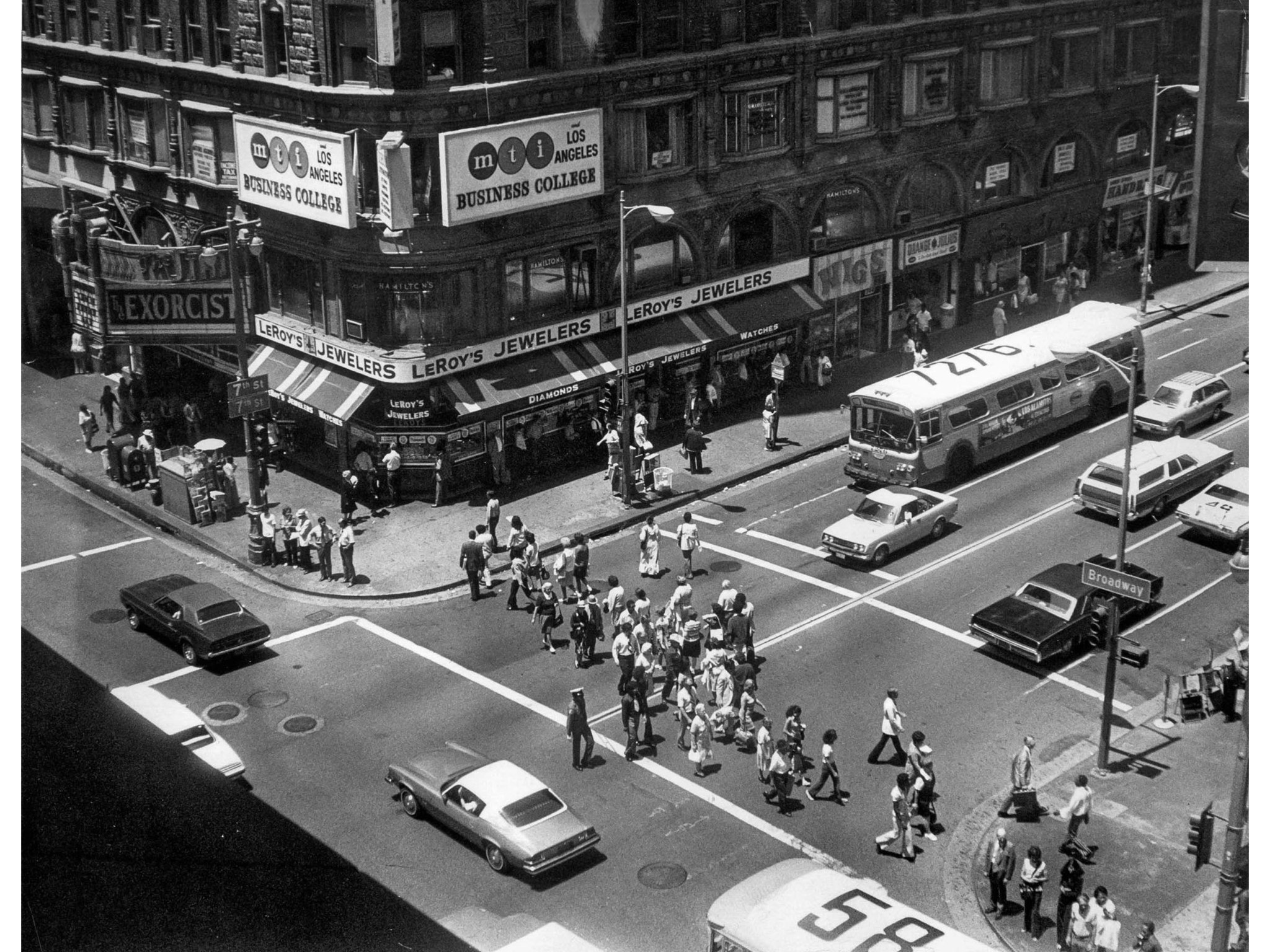 July 9, 1974: Pedestrians around noon at intersection of 7th and Broadway. This photo was published