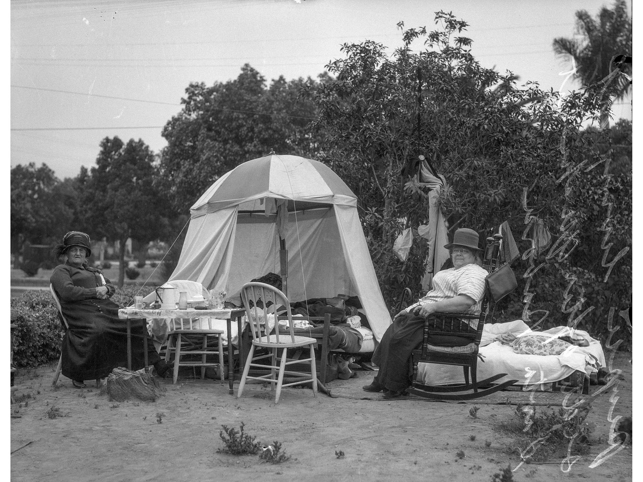 June 1925: Santa Barbara residents living in tent following 6.8 earthquake of June 29, 1925. Handwri