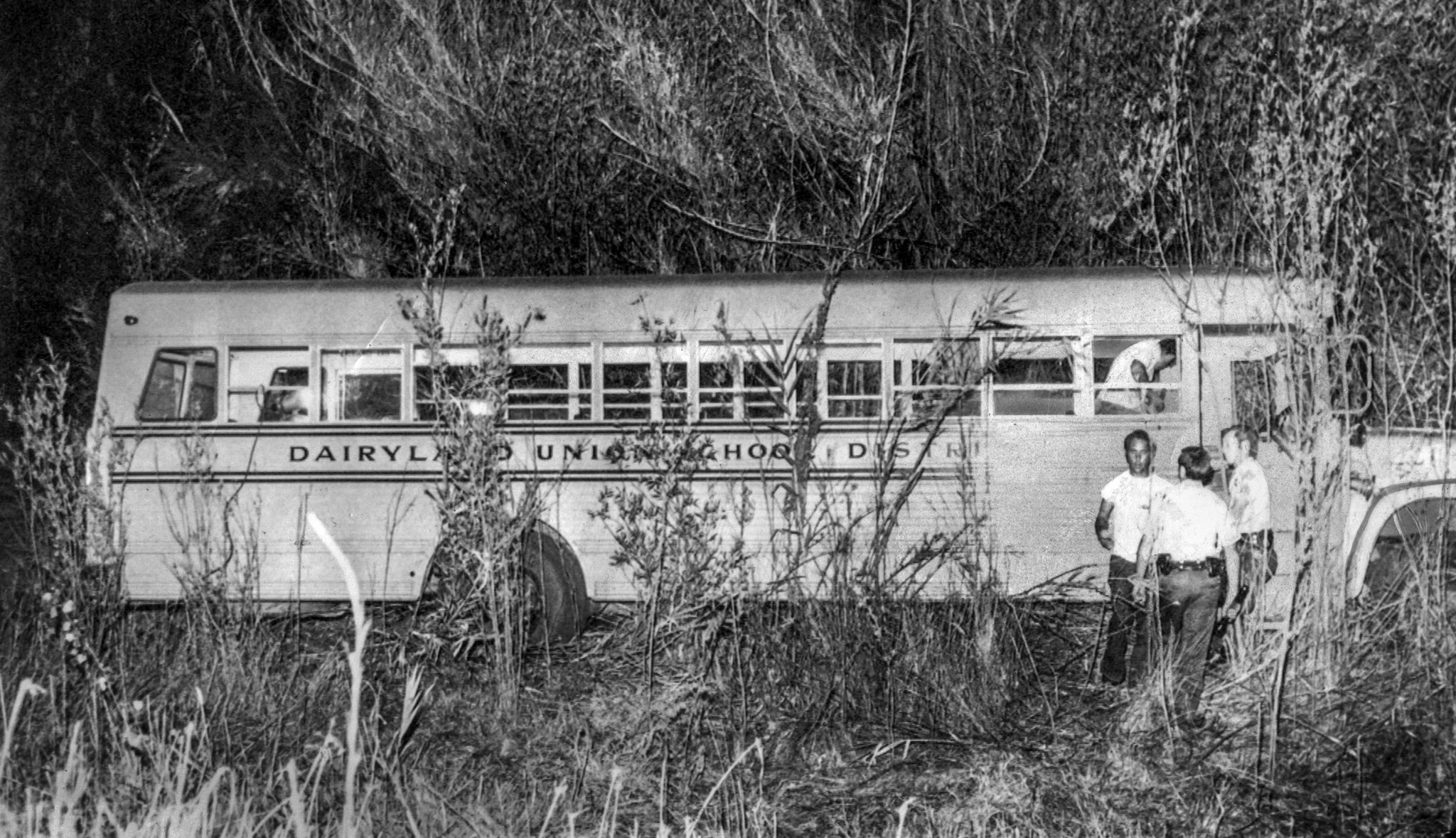July 16, 1976: Police and parents inspect the Dairyland Union school bus after it was found near Cho