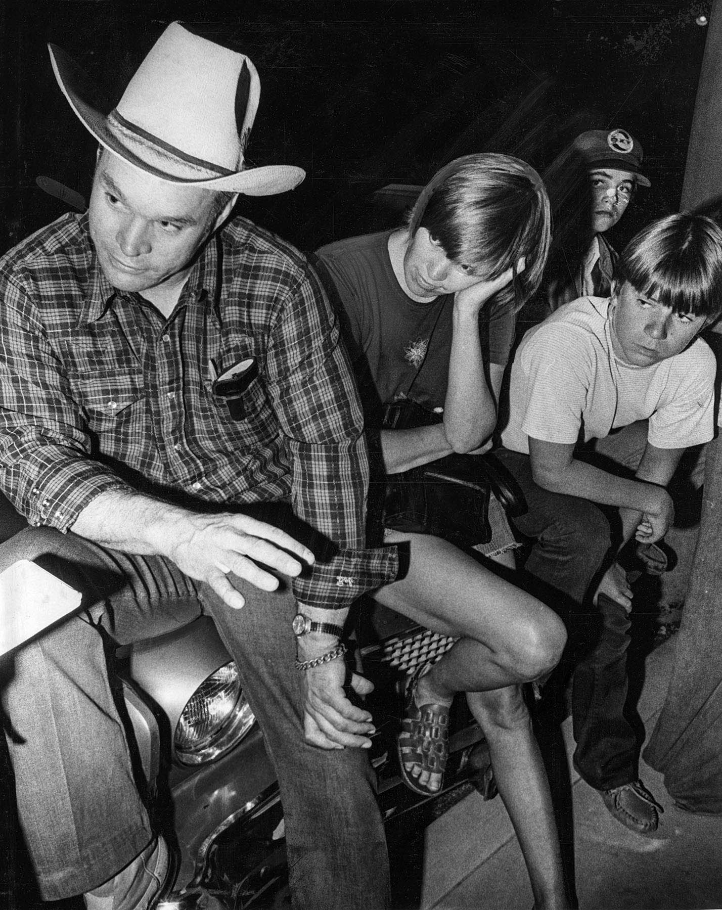 July 17, 1976: Bob, left, and Carol Marshall talk to a reporter while waiting at command post for re