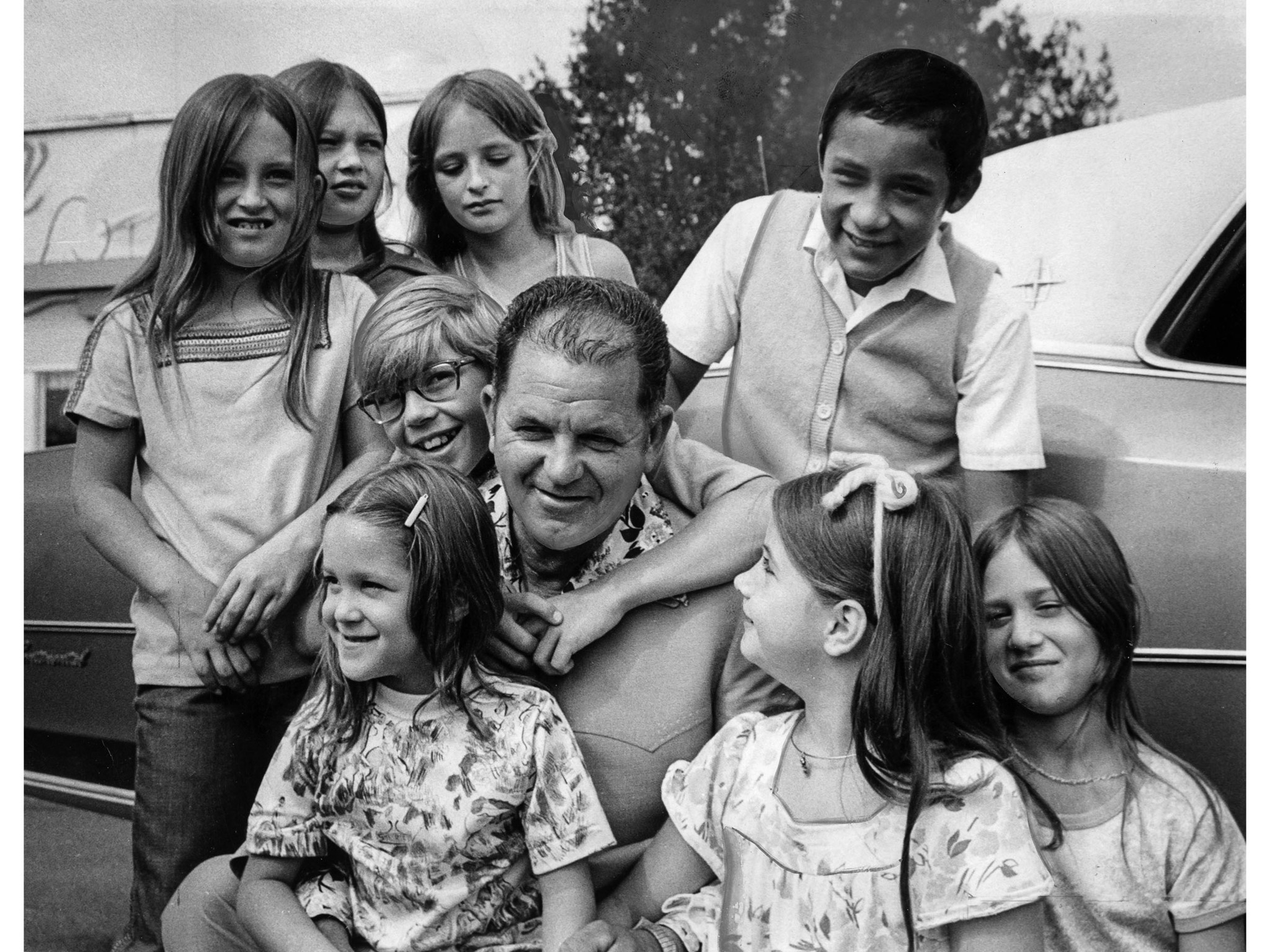 Aug. 22, 1976: Bus Driver Ed Ray is surrounded by some of the children he is credited with rescuing