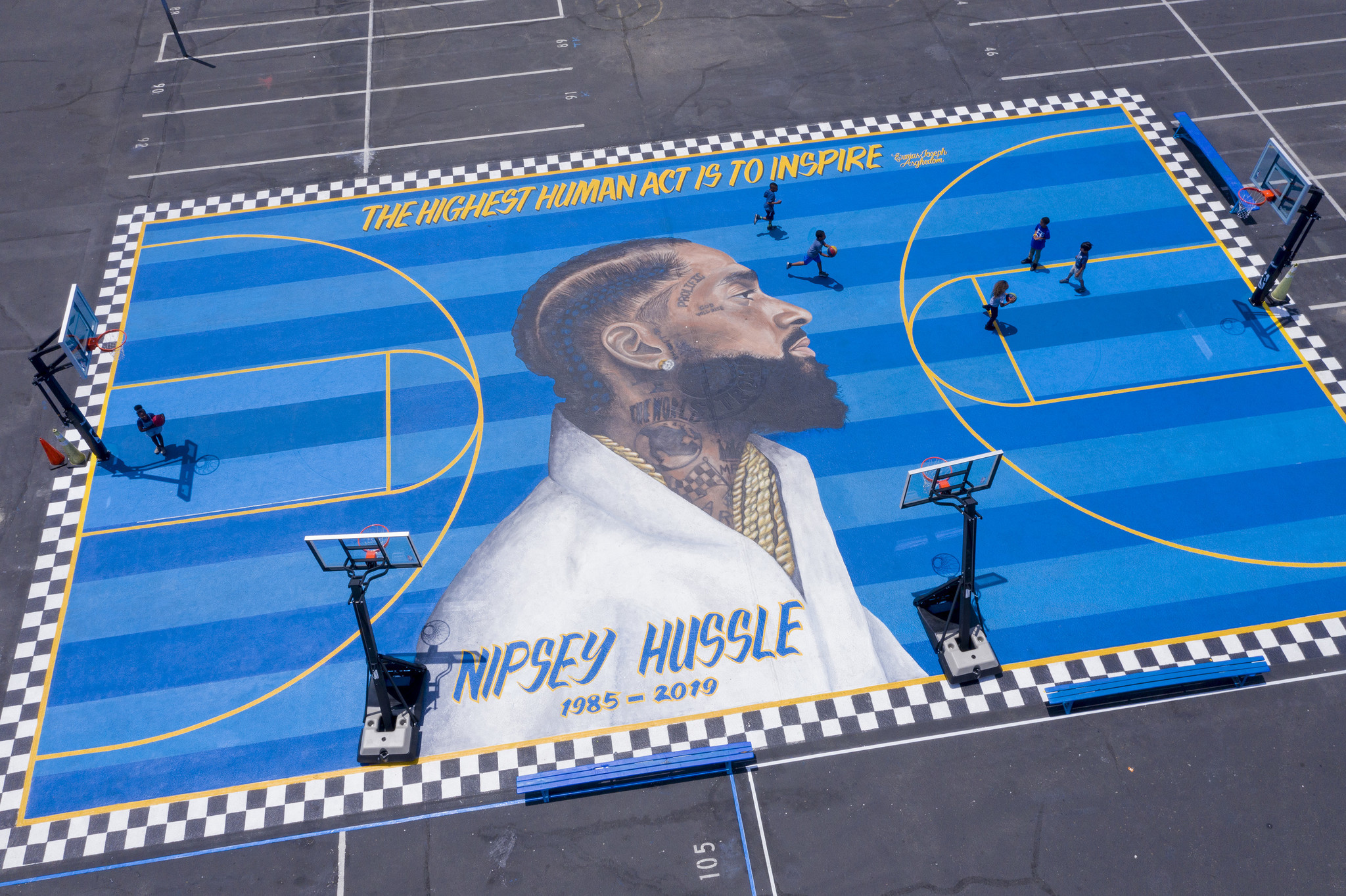 Basketball court with Nipsey Hussle mural
