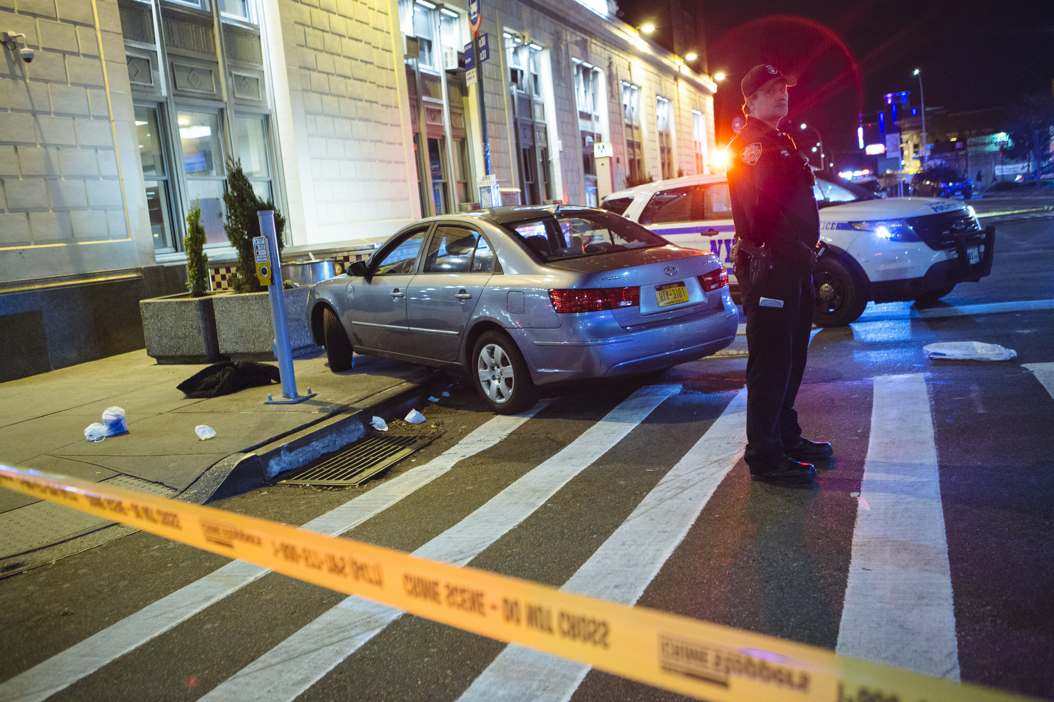 Hit-and-run driver in stolen car jumps curb, kills woman on Queens street: sources