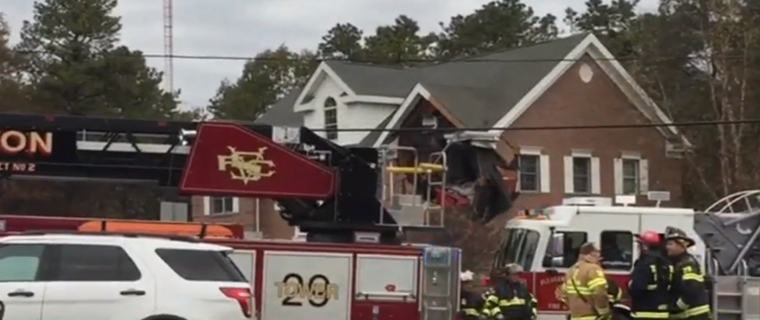 Two dead after car goes into second story of New Jersey building