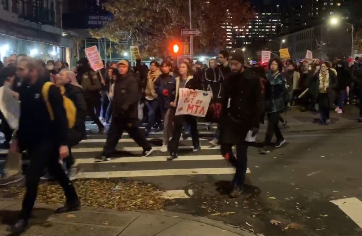 Hundreds of anti police protesters march in Harlem, about 20 reported arrested