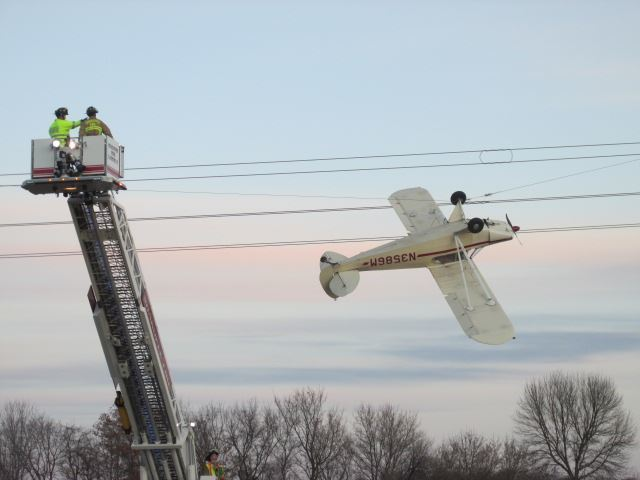 Plane left dangling upside-down after crashing into power lines in Minnesota