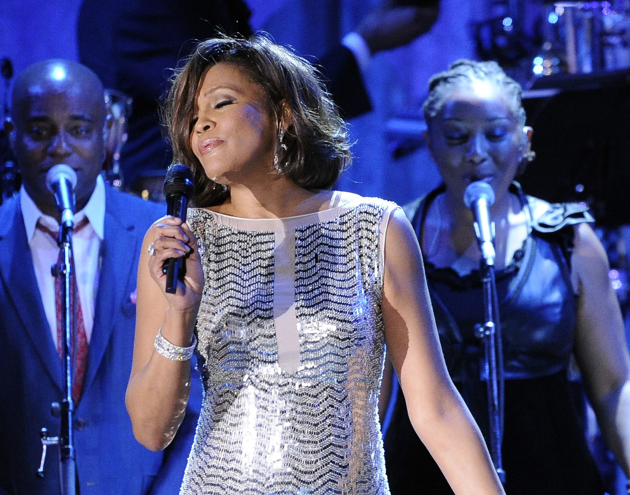 Items from Whitney Houston's storage unit, including gowns, are being auctioned off