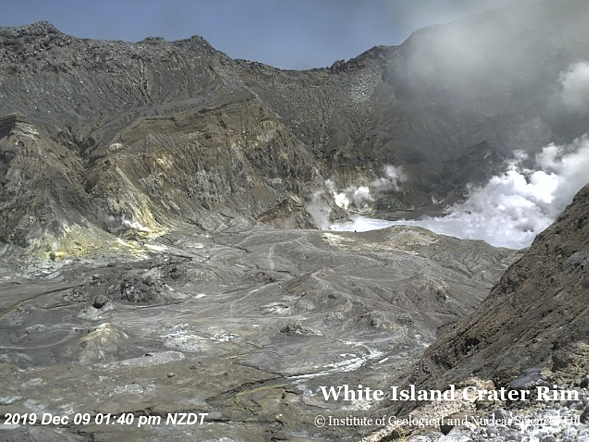 At least five dead, many others feared lost as volcano erupts on popular tourist island in New Zealand